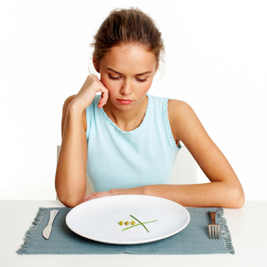 woman looking at food, by Healthista.com