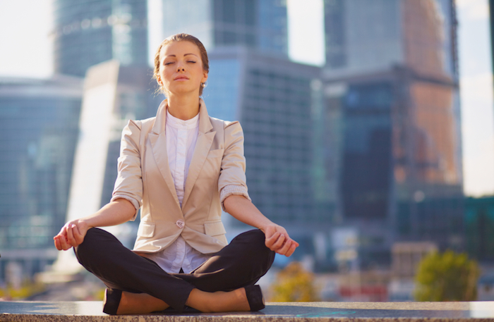 woman-meditating-in-city-meet-your-anti-ageing-and-anti-stress-hormones-by-Healthista.com