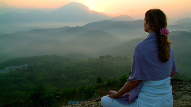 woman-overlooking-mountains-at-sunrise-meet-your-ant-stress-and-anti-ageing-hormones-by-Healthista.com