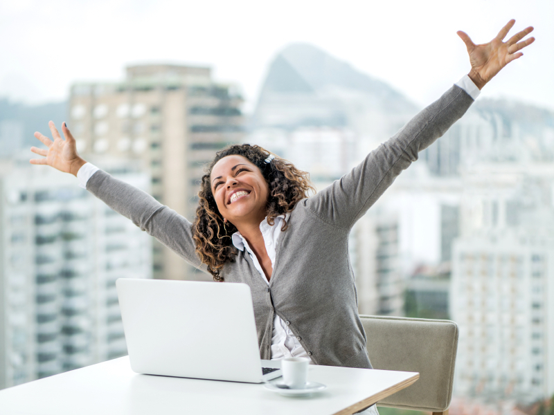 Woman-arms-raised-office-Re-energisers-at-your-desk-by-Healthista.com