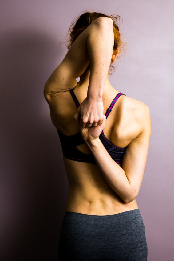woman-holding-wrists-does-yoga-encourage-eating-disorders-by-healthista.com
