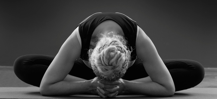 woman-in-forward-bend-does-yoga-encourage-eating-disorders-slider