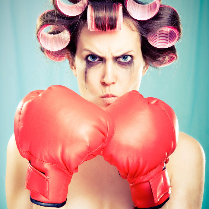 woman-with-boxing-gloves-7-ways-to-prevent-PMS-by-healthista.com-in-story