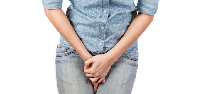 Woman-holding-pee-pericoach-pelvic-floor-toner-by-healthista.com-slider