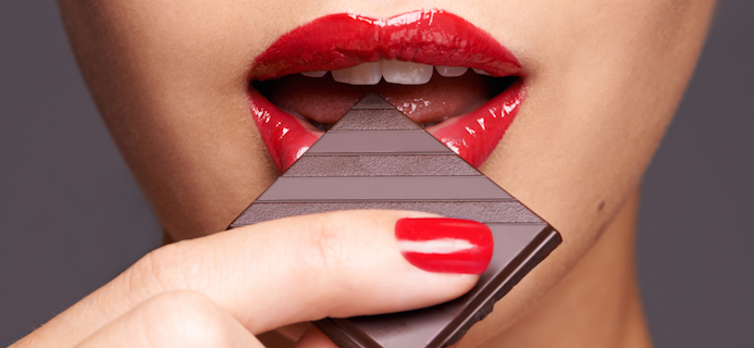 woman-eating-chocolate-8-reasons-for-emoitonal-eating-by-healthista.com-slider