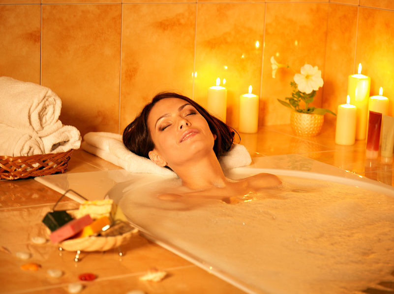 woman-mood-lit-bath-sore-mucles-by-Healthista.com