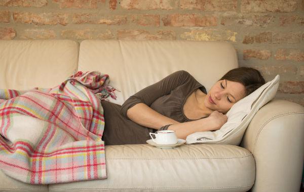 six sleep myths. woman on couch. healthista.com