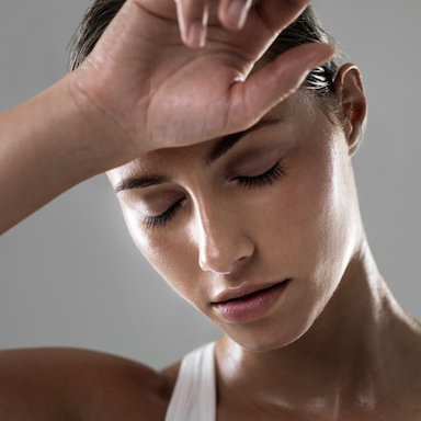 woman-hand-on-face-sleep-myths-making-you-tired-by-healthista.com