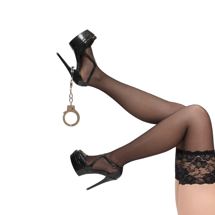 Woman legs with handcuffs, ways to spice up your sex life, by healthista.com