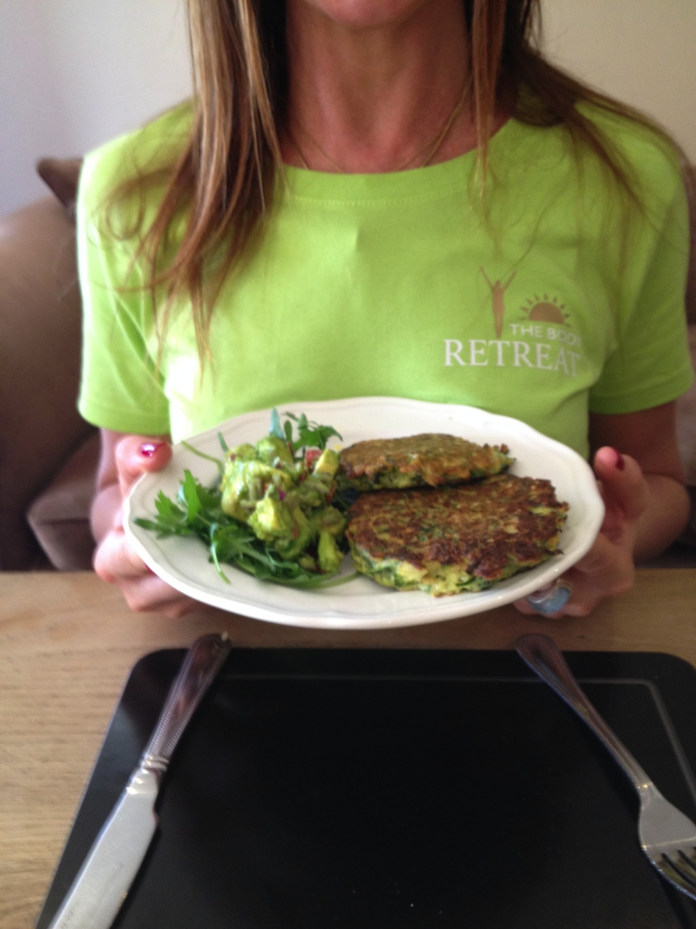courgette patties woman holding, ways to avoid sugar, by healthista.com