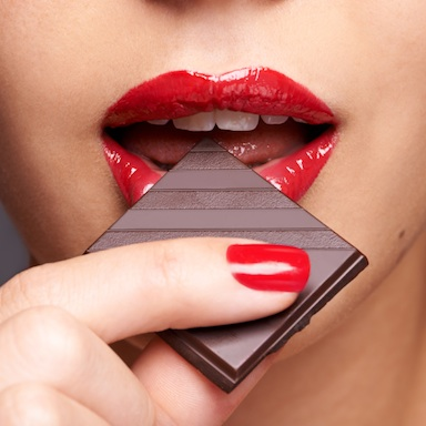 woman eating chocolate, best vegan chocolate, by healthista.com