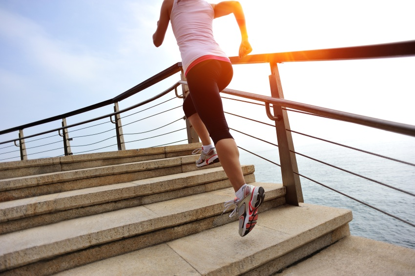 woman running up stairs, went to see a life coach, by healthista.com