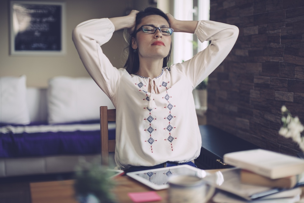 woman stressed at home, stress myths you probably believe, by healthista.com