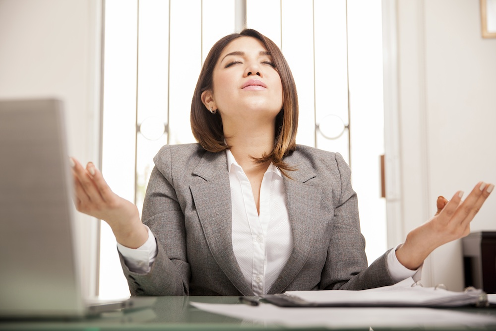 woman taking time to breathe at work, stress myths you probably believe, by healthista.com