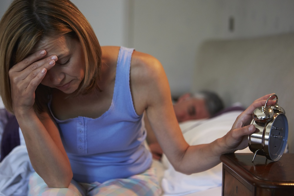 woman waking up to alarm, stress myths you probably believe, by healthista.com