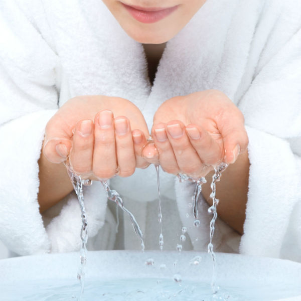 Washing Hands and face. 10 ways to deal with an anxiety attack. by Healthista