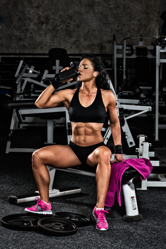 girl drinking a protein shake, how much protein do we really need