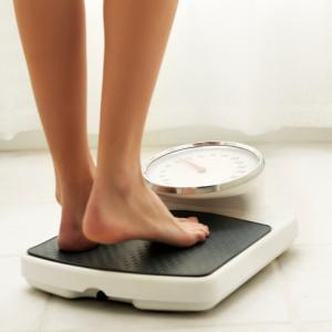 Woman's feet on scales, should I eat meat by healthista.com