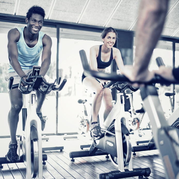 couple spinning on a bike, fitness trends for 2016 by Healthista.com