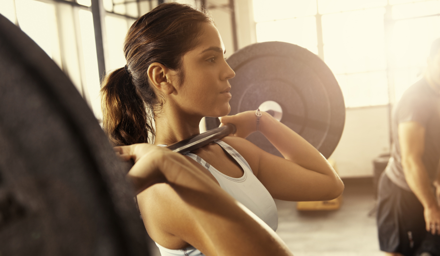 woman lifting weights fitness trends to stay by Healthista
