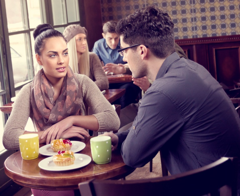 Couple having conversation over cofee, relationship problems, by healthista