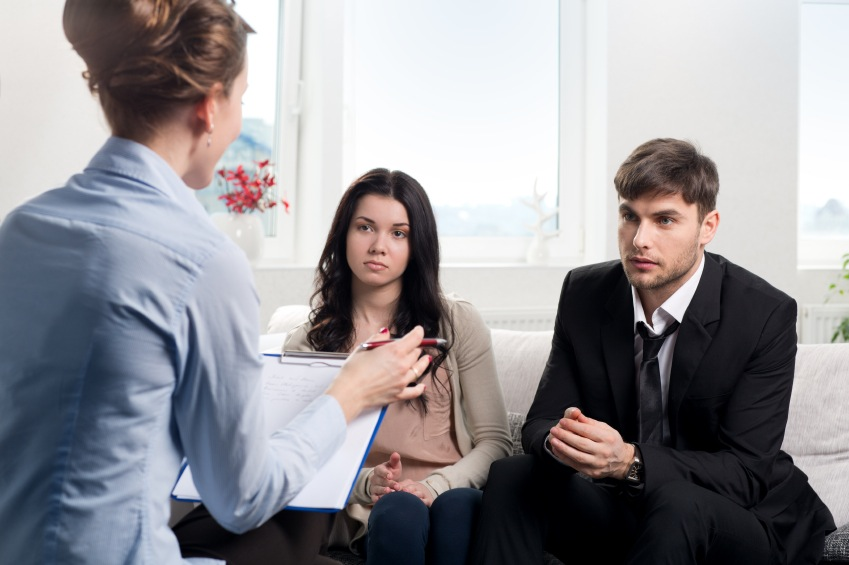 Young couple in therapy session, relationship problems, by healthista