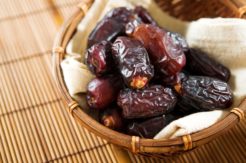 Dried date palm fruits in bamboo basket, 9 aphrodisiac foods by healthista