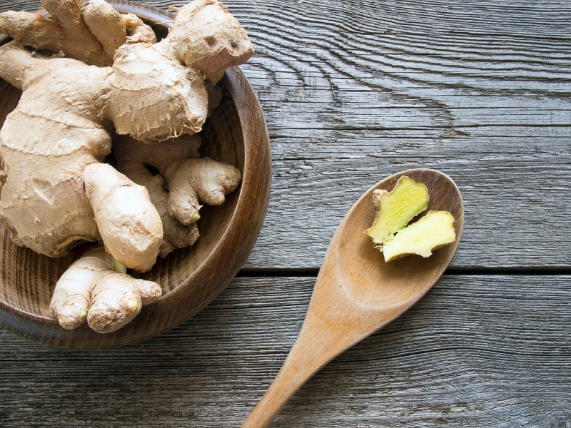 Ginger root in wooden bowl with wooden spoon, 9 aphrodisiac foods, by healthista