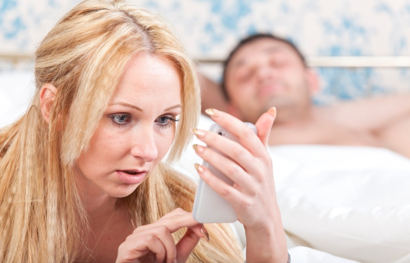 Girlfriend looking through boyfriends phone, relationship problems, by healthista