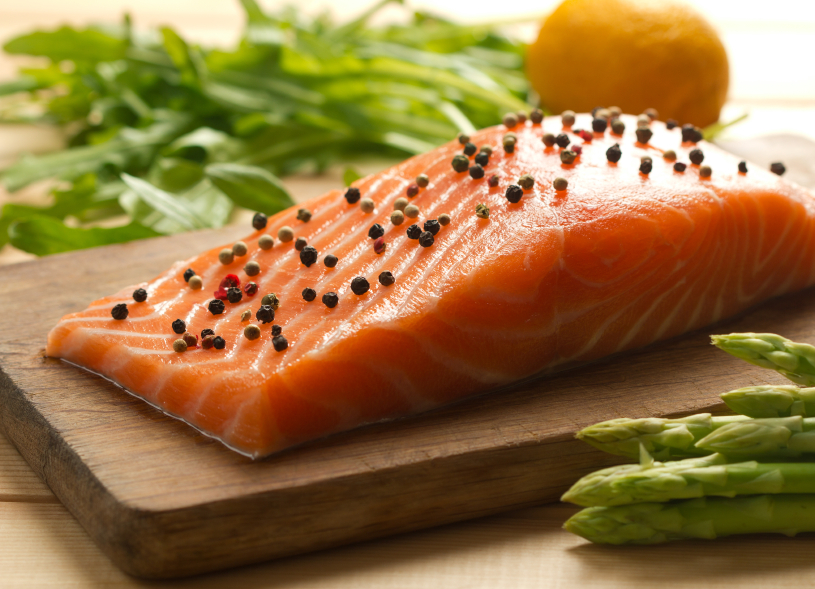 Salmon fillet with peppercorns and veg on wooden plank, 9 aphrodesiac foods, by healthista