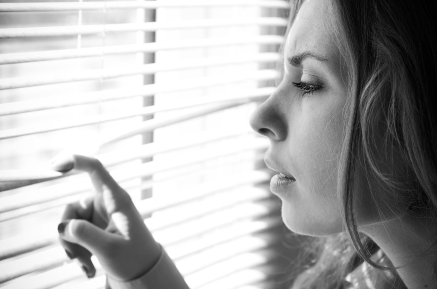 Woman looking through shutters, relationship problems, by healthista