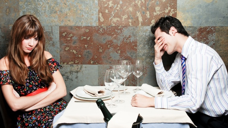 couple arguing over dinner, relationship problems, by healthista