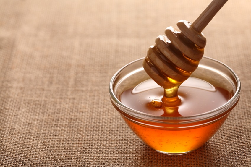 honey on cloth background, 9 aphrodisiac foods, by healthista