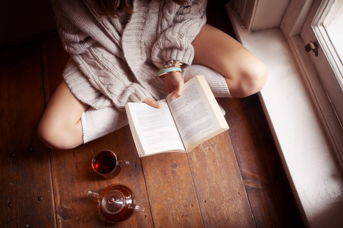 Woman reading book and drinking tea, 7 ways to boost your brain performance, by healthista.com