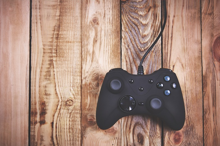 Xbox one controller on wooden floor, 7 ways to boost your brain performance, by healthista