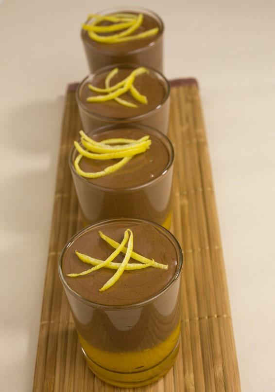 chocolate mousse on mango puree decorated with lemon zest