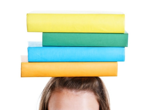 balancing books on head, 7 ways to get rid of back pain, by healthista