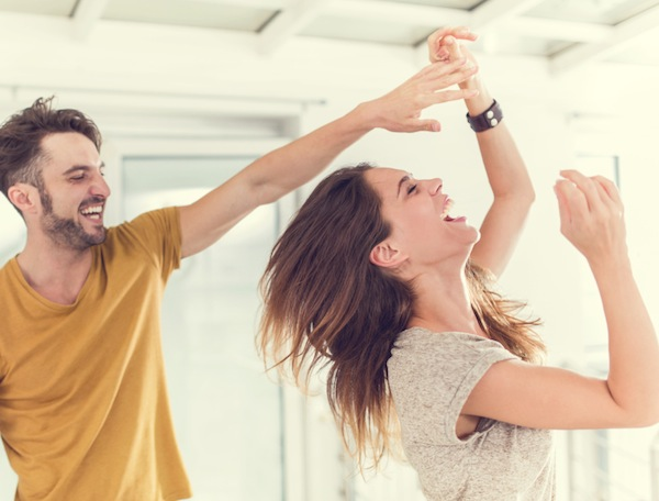 couple dancing together at home, 6 hacks that will make your relationship stronger, by healthista