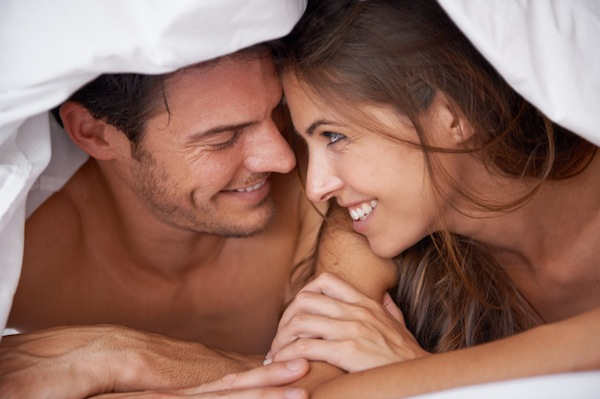 couple talking under the covers, 6 hacks that will make your relationship stronger, by healthista