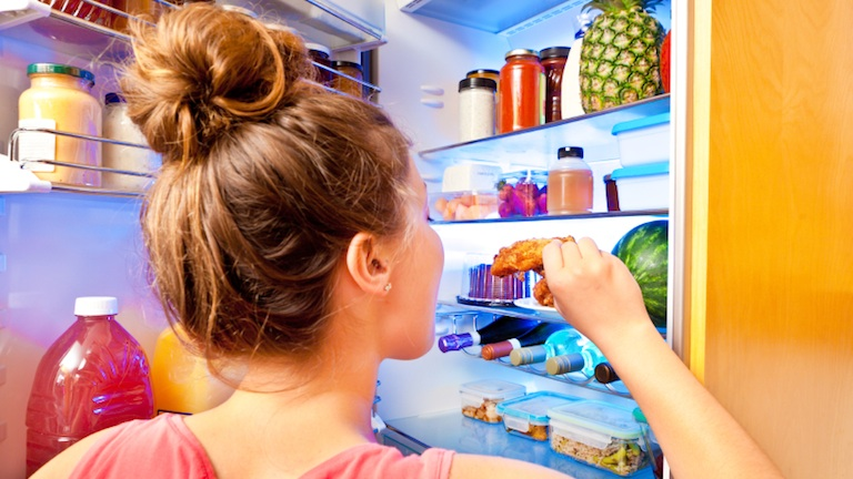woman eating from fridge, 11 reasons you're always hungry, by healthista