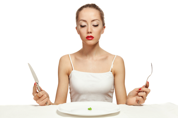 Hungry young woman on a diet, 7 diet myths, by healthista