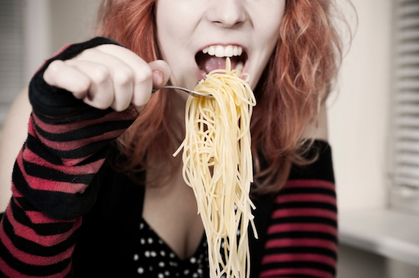 woman eating spagetti, 11 reasons you're always hungry, by healthista