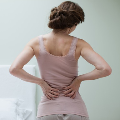 woman with back pain, 7 ways to get rid of back pain, by healthista.com