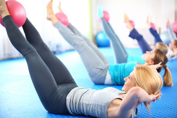 women in a pilates class, 7 ways to get rid of back pain, by healthista