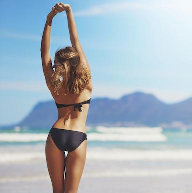 woman in bikini infront of mountains, bikini body challenge, by healthista