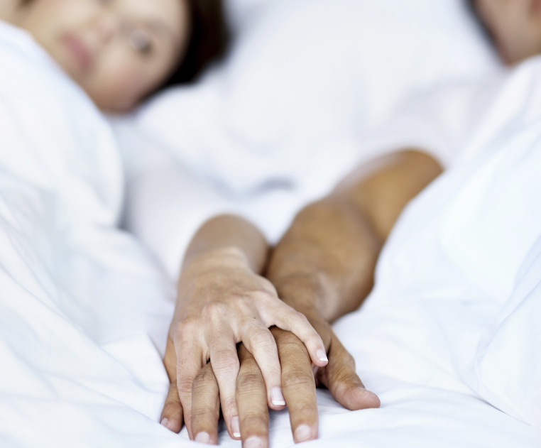 holding-hands-in-bed-vaginal-dryness-vagisil-by-healthista.