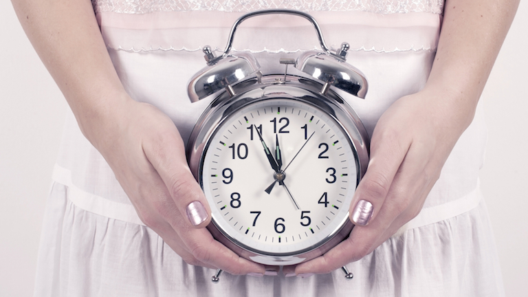 woman-holding-clock-how-to-make-your-body-clock-work-for-you-by-healthista.