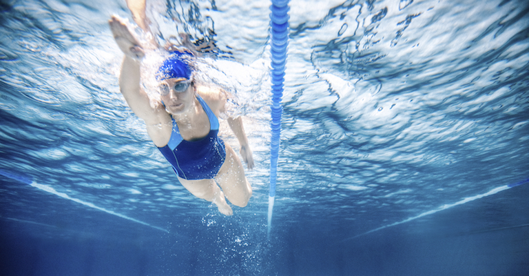 woman swimming, how to make your body clock work for you, by healthista