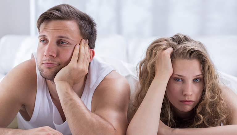 fed up couple laying in bed, my boyfriend can't get an erection. by healthista.