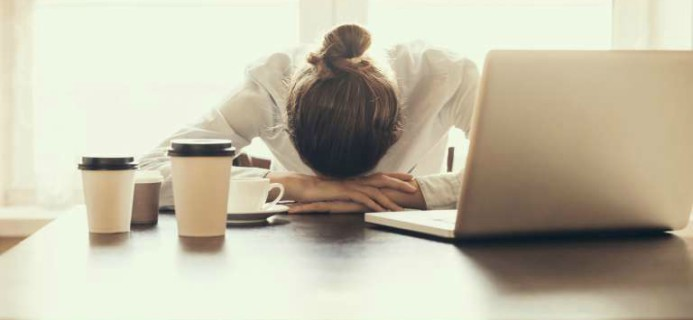woman-tired-at-work-breast-cancer-by-healthista